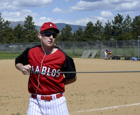 Senior Airman Devin Mooney, 321st Missile Squadron commander's support staff and Personnel Reliability Program monitor, warms up before a game with his Fort Collins league baseball team May 29, 2016, in a field in Colorado. Mooney will try out for a Major League Baseball team in June. (U.S. Air Force photo by Senior Airman Jason Wiese)