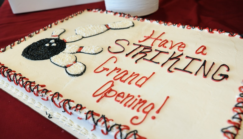 A customized cake waits to be cut during the Stars and Strikes Bowling Center grand opening at Whiteman Air Force Base, Mo., June 10, 2016. The new facility includes flat-screen monitors, large projectors, an expanded dining and kitchen area, and outdoor seating. (U.S. Air Force photo by Senior Airman Danielle Quilla)