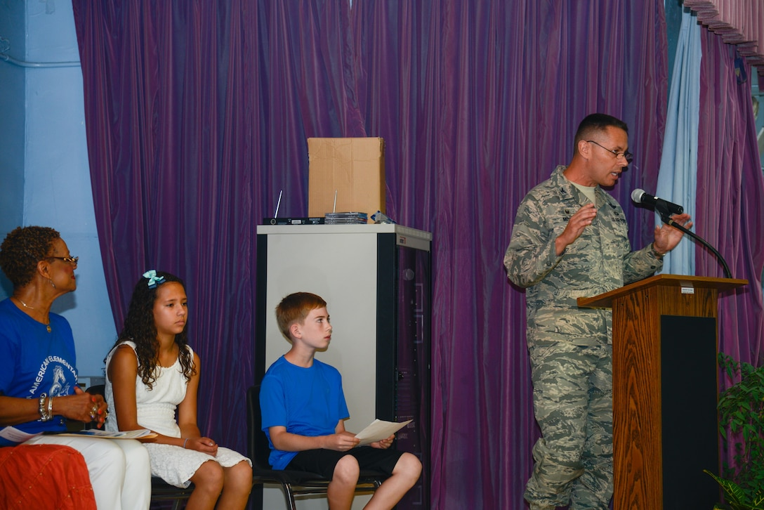 Col. Carl Misner, 51st Mission Support Group commander, speaks during the Osan Elementary School closing ceremony June 15, 2016, at Osan Air Base, Republic of Korea. Misner thanked the school faculty for teaching Osan's youngest. (U.S. Air Force photo by Senior Airman Dillian Bamman/Released)