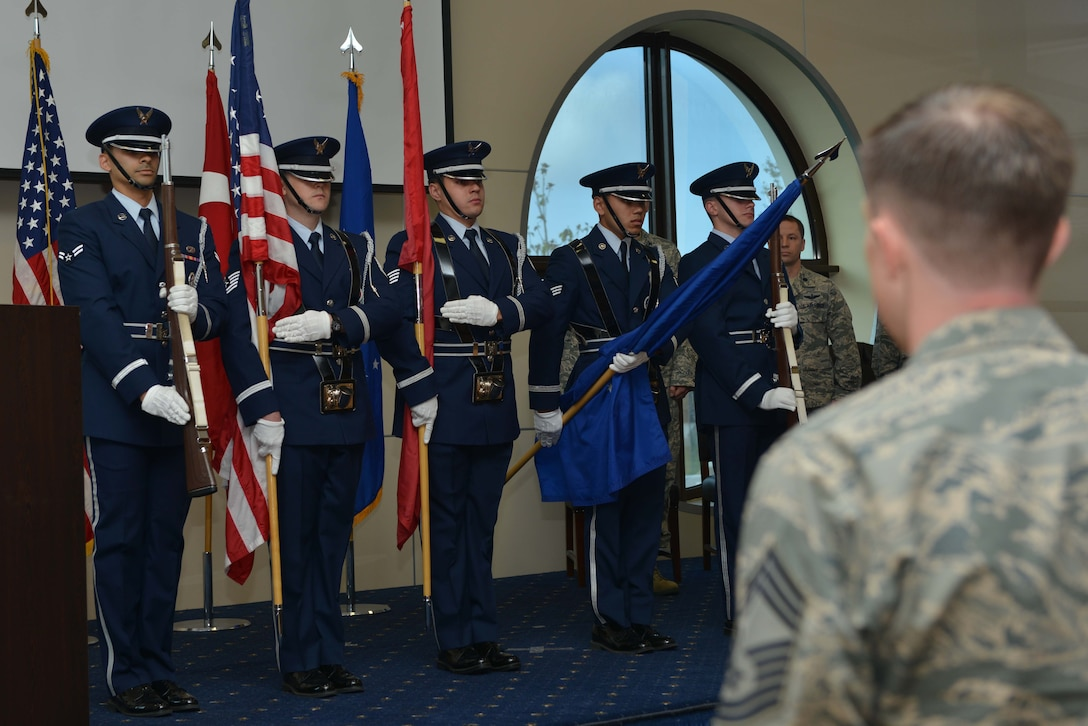 Airmen from the Incirlik Air Base honor guard present the colors during a change of command ceremony June 16, 2016, at Incirlik AB, Turkey. A change of command ceremony is a tradition that represents a formal transfer of authority and responsibility from the outgoing commander to the incoming commander. (U.S. Air Force photo by Senior Airman John Nieves Camacho/Released)