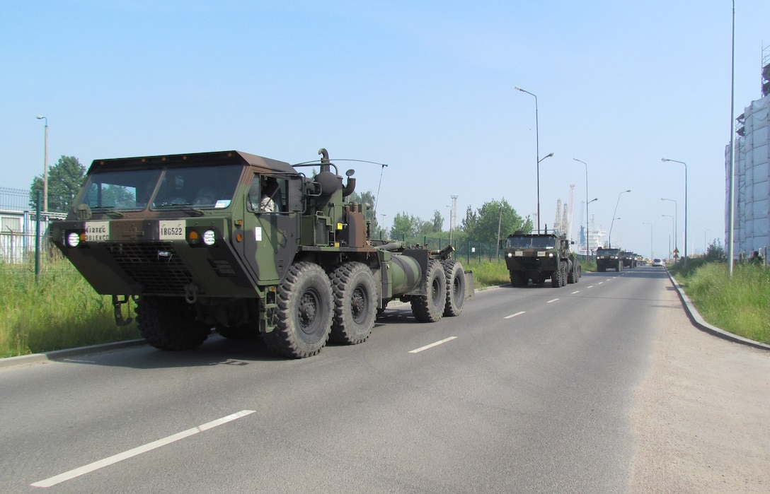 Vehicles from the U.S. Army Reserve 361st Multi Role Bridge Co., 412th Theater Engineer Command, leave the port in Szczecin, Poland Saturday, June 4, 2016 headed for Exercise Anakonda 16.