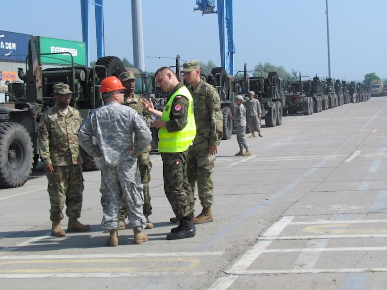 U.S. and Polish Soldiers ready a convoy of vehicles of the 361st Multi Role Bridge Co. to leave the port in Szczecin, Poland to take part in Exercise Anakonda 16.