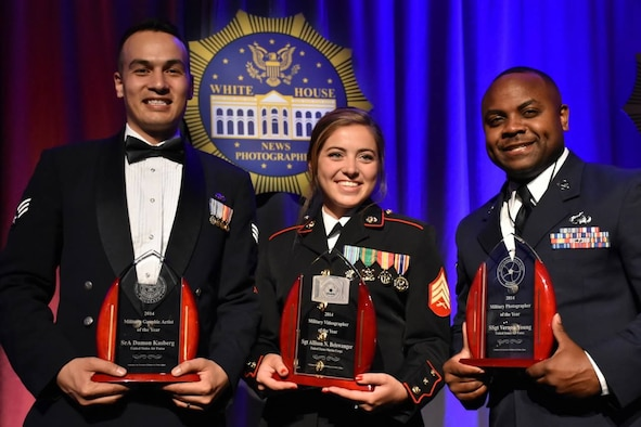 U.S. Air Force Senior Airman Damon Kasberg (left), 2014 Visual Information Award Program Military Graphic Artist of the Year from 86th Airlift Wing Public Affairs, U.S. Marine Corps Sgt. Allison N. Beiswanger, 2014 VIAP Military Videographer of the Year  from Office of USMC Communications (middle) and USAF Staff Sgt. Vernon Young (right),2014 VIAP Military Photographer of the Year from Defense Media Activity Airman Magazine, pose for a photo with their awards May 17, 2015, in the District of Columbia. Kasberg was also awarded Military Graphic Artist of the Year for 2015 and will attend a ceremony in D.C. on June 18. (Courtesy Photo)