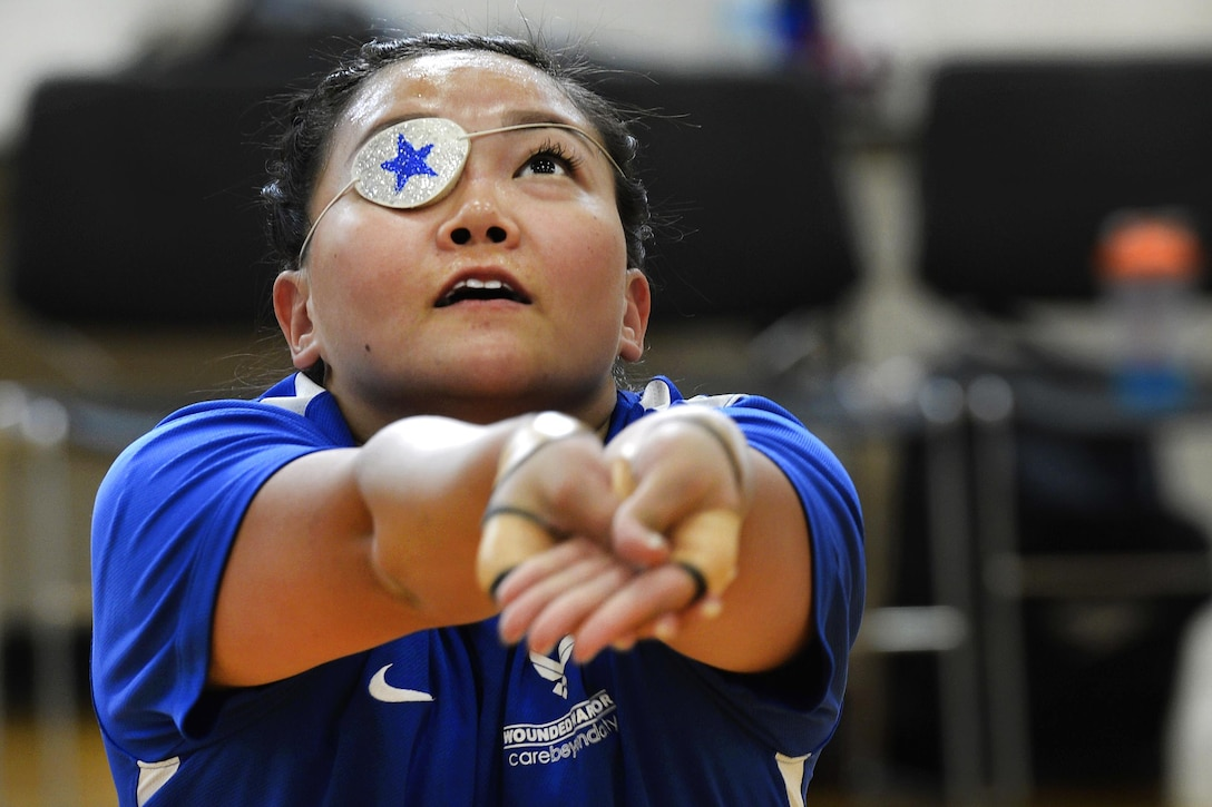 Air Force 1st Lt. Sarah Frankosky practices sitting volleyball