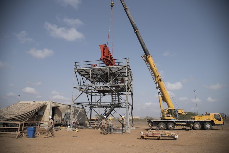 Airmen from the 205th Engineering Installation Squadron, out of Oklahoma City, install a new AN/GPN-27 Airport Surveillance Radar System tower June 4, 2016, at Camp Lemonnier, Djibouti. With coordination between the 205th EIS, U.S. Air Forces in Europe, Air Force Flight Standards Agency, U.S. Air Forces Central Command and the U.S. Navy, the new radar will increase air traffic control capabilities and safety. (U.S. Air Force photo/Staff Sgt. Tiffany DeNault)