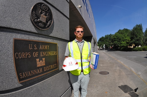 Mark Hiscox, a student in Auburn University's Construction Management Program and contracting specialist at the Savannah District, displays contracting and construction tools of the trade at district headquarters June 15, 2016. Hiscox is one of more than 60 district employees who've enrolled in the degree-awarding program promoted to mend information and communication gaps between construction and contracting specialists. The program blends practical and professional construction education principles for working professionals. It also focuses on holistic communities of practice for students who need to understand interdisciplinary concepts in dynamic team environments.