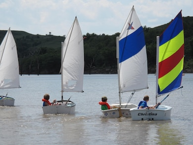 Young Sailors doing it right: everyone is wearing a personal flotation device. It's the law, and it's water-wise.