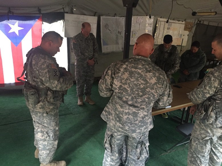 Soldiers of the 398th Combat Sustainment Support Battalion bow their heads in prayer during WAREX 91-16-02 at Fort Hunter Liggett, Cali.  Chaplains provided emotional and spiritual support during the exercise.