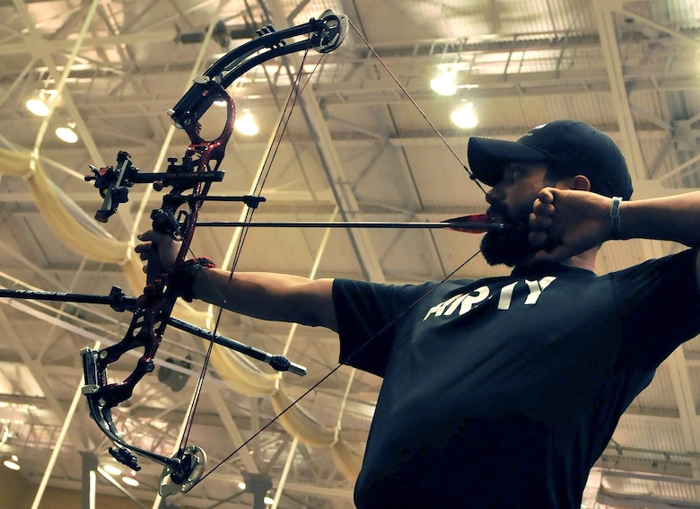 U.S. Army Veteran Staff Sgt. Eric Pardo draws a bead on the target during the Team Army archery training in preparation for the 2016 Department of Defense Warrior Games held at the United States Military Academy at West point, New York, June 13. The DoD Warrior Games, June 15-21, is an adaptive sports competition for wounded, ill and injured service members and Veterans. Athletes representing teams from the Army, Marine Corps, Navy, Air Force, Special Operations Command and the United Kingdom Armed Forces compete in archery, cycling, track, field, shooting, sitting volleyball, swimming, and wheelchair basketball. (US Army photo by Master Sgt. D. Keith Johnson/Released)