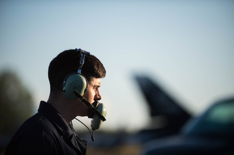 U.S. Air Force Senior Airman Brendan Tarbett, a 354th Aircraft Maintenance Squadron avionics technician, controls a test run on an F-16 Fighting Falcon fighter aircraft while working swing shift June 14, 2016, during RED FLAG-Alaska (RF-A) 16-2 at Eielson Air Force Base, Alaska. Jets are flown almost double the normal hours during RF-A, increasing the need for maintenance, which provides training for support personnel in sustainment of large-force deployed air operations. (U.S. Air Force photo by Staff Sgt. Shawn Nickel/Released)