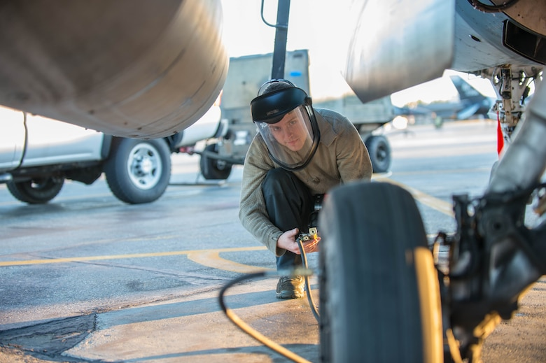 Airman 1st Class Ryan Bateman, a 354th Aircraft Maintenance Squadron assistant dedicated crew chief, tops off the air in the tire of an F-16 Fighting Falcon fighter aircraft while working swing shift June 14, 2016, during RED FLAG-Alaska (RF-A) 16-2 at Eielson Air Force Base, Alaska. RF-A 16-2, the largest exercise of it's kind in six years, simulates the first 10 combat sorties during the initial stages of war or a surge operation, providing training for support personnel in sustainment of large-force deployed air operations. (U.S. Air Force photo by Staff Sgt. Shawn Nickel/Released)