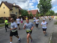 U.S. Army Reserve Soldiers with the 364th Expeditionary Sustainment Command, Marysville, Washington, participate in a 10-kilometer run through the Polish town Sulejowek during Anakonda 2016, June 11. Anakonda 16 is a Polish-led national event that seeks to train, exercise and integrate Polish national command and force structures into an Allied, joint, multinational environment. (Photo by Capt. A. Sean Taylor, 649th RSG)