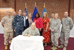 Defense Logistics Agency Aviation Commander Air Force Brig, Gen. Allan Day signs the DLA Aviation Process Excellence policy June 14, 2016 at Defense Supply Center Richmond, Virginia.