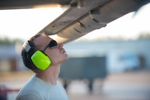 U.S. Air Force Staff Sgt. Nathan Mendoza, a 354th Maintenance Squadron aircraft armament systems craftsman, inspects a Captive AIM-9 missile after loading it onto an  F-16 Fighting Falcon fighter aircraft while working swing shift June 14, 2016, during RED FLAG-Alaska (RF-A) 16-2 at Eielson Air Force Base, Alaska. Jets are flown almost double the normal hours during RF-A, increasing the need for maintenance, which provides training for support personnel in sustainment of large-force deployed air operations. (U.S. Air Force photo by Staff Sgt. Shawn Nickel/Released)