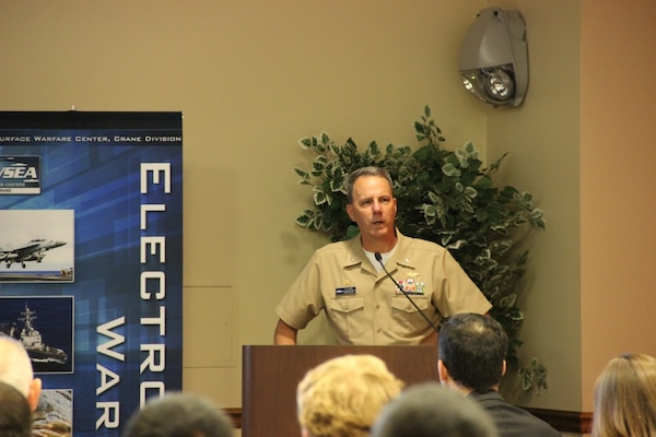 CRANE, Ind. - 160510-N-QI541-014 - CAPT JT Elder provides welcome remarks for the Eighth Annual Electronic Warfare (EW) Capability Gaps and Enabling Technologies Operational and Technical Information Exchange conference co-hosted by The Association of Old Crows (AOC) and Naval Surface Warfare Center Crane (NSWC Crane) at Navy Support Activity (NSA) Crane's Club Lakeview.