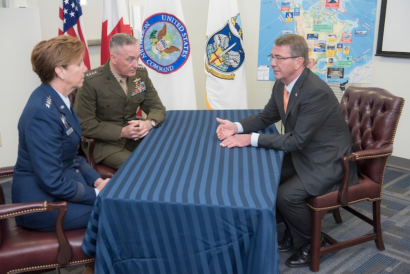Marine Corps Gen. Joe Dunford, chairman of the Joint Chiefs of Staff, and Air Force Gen. Lori J. Robinson, commander of U.S. Northern Command and North American Aerospace Defense Command, speak with Defense Secretary Ash Carter at Peterson Air Force Base, Colo., May 13, 2016. Robinson provided remarks at the United State of Women Summit in Washington, D.C., June 14, 2016. DoD photo by Navy Petty Officer 2nd Class Dominique A. Pineiro