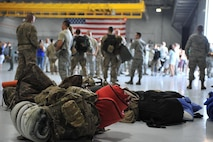 Bags rest on the 823rd Maintenance Squadron hangar floor at Nellis Air Force Base, Nev. Jun 7. Airmen from the 823rd MXG and 66th RQS spent the last four months in Afghanistan providing personnel recovery support. (U.S. Air Force photo by Senior Airman Rachel Loftis)