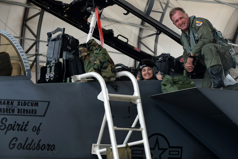 Julie Daniels (left), Military Affairs Committee chairperson, and Col. Mark Slocum (right), 4th Fighter Wing commander, prepare to take off in an F-15E Strike Eagle, June 14, 2016, at Seymour Johnson Air Force Base, North Carolina. As an honorary commander of Seymour Johnson AFB, Daniels was invited to fly with Slocum to familiarize herself with the F-15E capabilities. (U.S. Air Force photo by Airman 1st Class Ashley Williamson/Released)