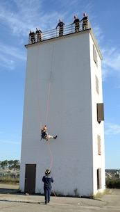 A Marine Corps Junior Reserve Officers Training Corps cadet from Plaquemine High School, Plaquemine, La., rappels down a tower during a Cadet Leadership Camp aboard Marine Corps Logistics Base Albany, June 8.