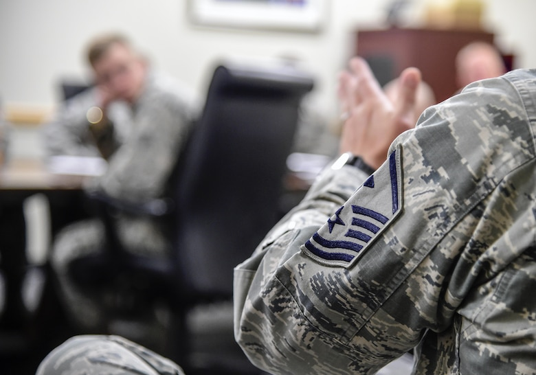 Master Sgt. Jessie Thomas, Air Reserve Personnel Center first sergeant, discusses how first sergeants handle unique situations involving Airmen during a mentoring session June 15, 2016, at Buckley Air Force Base, Colo. The cadets toured Buckley's units and missions, while engaging with leaders of all ranks in order to gain a better understanding of an operational air force base. (U.S. Air Force photo by Tech. Sgt. Nicholas Rau)