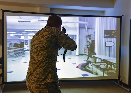 Cadet Alex Korskey, U.S. Air Force Academy, engages in an exercise active shooter scenario hosted by the 460th Security Forces Squadron during a mission briefing June 15, 2016, at Buckley Air Force Base, Colo. The cadets toured Buckley's units and missions, while engaging with leaders of all ranks in order to gain a better understanding of an operational air force base. (U.S. Air Force photo by Tech. Sgt. Nicholas Rau)