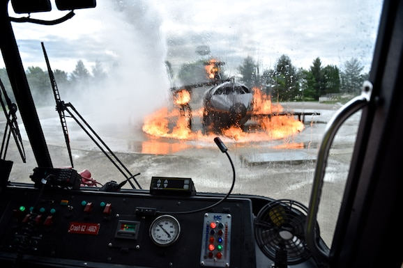 "Tech. Sgt. Christopher Parr, 932nd Public Affairs, had the opportunity to ride inside during a training evolution and document the 932nd Civil Engineer Squadron firefighters. ""The experience to participate and document the outstanding Airmen of the 932nd makes my job the best in the Air Force, "" said Parr.  (U.S. Air Force photo by Tech. Sgt. Christopher Parr)"