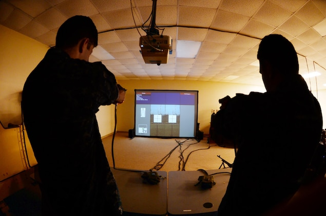 Shooters aim at simulated targets using Marine Corps Logistics Base Albany's Indoor Simulated Marksmanship Trainer, recently.