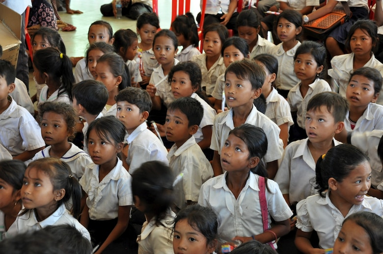 Children from the Angchhum Trapeang Chhouk School in Kampot Province, Cambodia listen intently as they learn about oral hygiene as part of a health services outreach event June 15, 2016, for Pacific Angel 16-2 in Cambodia. The children were taught how and when to properly brush their teeth, then were provided a general dental examination and fluoride treatment. Oral hygiene is particularly important for children because if primary teeth get cavities, it could later cause infection or problems with their adult teeth. The school outreach event was planned and executed by non-governmental agencies in coordination with U.S., Cambodian, Australian, Vietnamese and Thai counterparts in order to educate the population on preventative health throughout the region. (U.S. Air Force photo by Capt. Susan Harrington/Released)