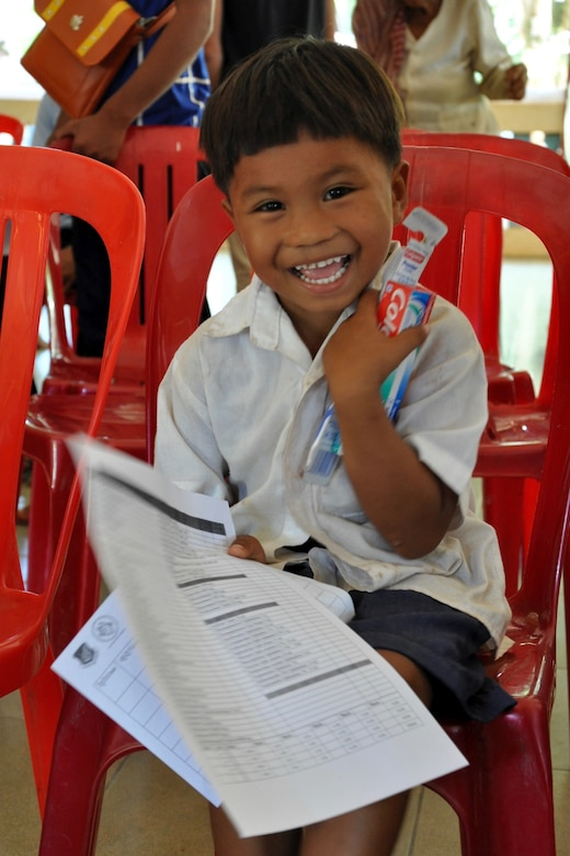A young Cambodian boy smiles after he receives his toothbrush and toothpaste from Pacific Angel 16-2 Cambodia dentists and dental technicians June 15, 2016.  Dental providers from East Meets West, a non-governmental organization based in Vietnam, partnered with U.S., Cambodian, Australian, Vietnamese and Thai military counterparts as part of Pacific Angel 16-2, a multilateral humanitarian assistance/civil military mission, to provide the multitude of children basic dental examinations and, more importantly, educate them on the importance of proper dental hygiene. Each child was given a toothbrush and toothpaste and was educated on how to properly brush their teeth at home. (U.S. Air Force photo by Capt. Susan Harrington/Released)