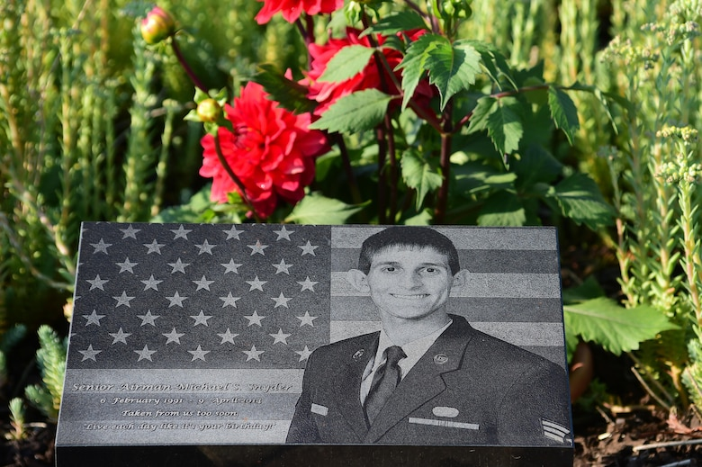 A memorial garden for Senior Airman Michael S. Snyder lays in front of the 460th Space Communications Squadron Building June 16, 2016, on Buckley Air Force Base, Colo. Snyder was tragically killed in 2014 by a drunk driver while riding his motorcycle off base. (U.S. Air Force photo by Airman 1st Class Luke W. Nowakowski/Released)
