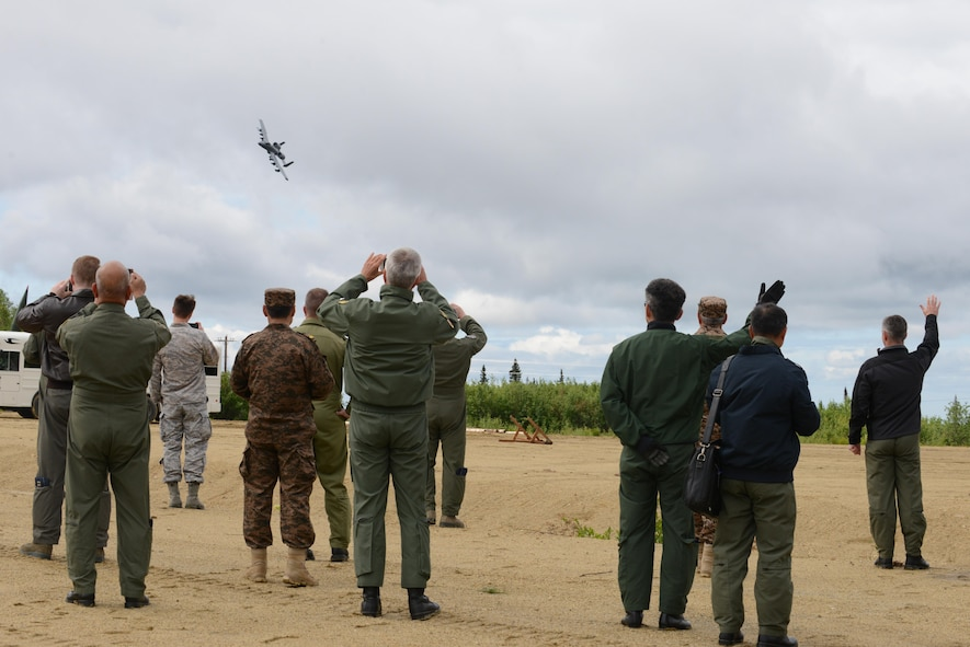 U.S. Air Force and senior airpower leaders from the global community watch as an A-10 Thunderbolt II from Davis-Monthan Air Force Base, Ariz., flies by in a show of force demonstration for the Executive Observer Program (EOP), June 13, 2016, in the Joint Pacific Alaska Range Complex during RED FLAG-Alaska 16-2. The EOP allows participants the opportunity to experience U.S. Pacific Air Forces' premier multinational large force employment. (U.S. Air Force photo by Staff Sgt. Ashley Nicole Taylor/Released)
