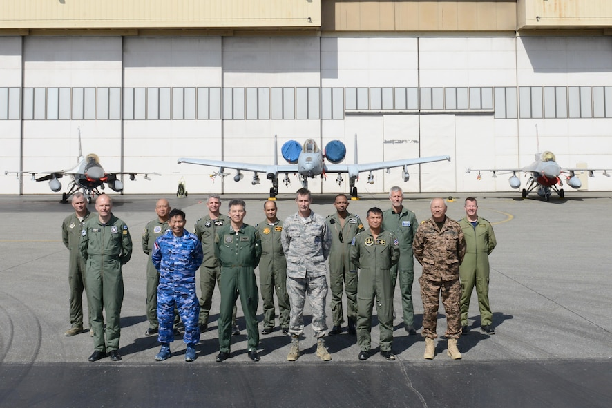 After experiencing show of force demonstrations that highlighted combat capabilities offered to nations participating in RED FLAG-Alaska (RF-A) exercises, senior leaders from the global community stand together for a group photo in front of RF-A 16-2 participating fighter jets June 13, 2016, at Eielson Air Force Base, Alaska. Leaders spent a total of four days together at Joint Base Elmendorf-Richardson and Eielson strengthening foreign relations and showcasing the joint environment unmatched by other exercises. (U.S. Air Force photo by Staff Sgt. Ashley Nicole Taylor/Released)