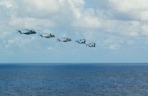 PACIFIC OCEAN (July 29, 2014) - Two MV-22 Ospreys, assigned to Marine Medium Tiltrotor Squadron (VMM) 161, and three CH-53E Super Sea Stallions, assigned to the Marine Heavy Helicopter Squadron (HMH) 465, fly in formation after launching from the amphibious assault ship USS Peleliu (LHA 5) while underway during Rim of the Pacific (RIMPAC) Exercise 2014. Twenty-two nations, 49 ships and six submarines, more than 200 aircraft and 25,000 personnel are participating in RIMPAC exercise from June 26 to Aug. 1, in and around the Hawaiian Islands and Southern California. The world's largest international maritime exercise, RIMPAC provides a unique training opportunity that helps participants foster and sustain the cooperative relationships that are critical to ensuring the safety of sea lanes and security on the world's oceans. RIMPAC 2014 is the 24th exercise in the series that began in 1971.