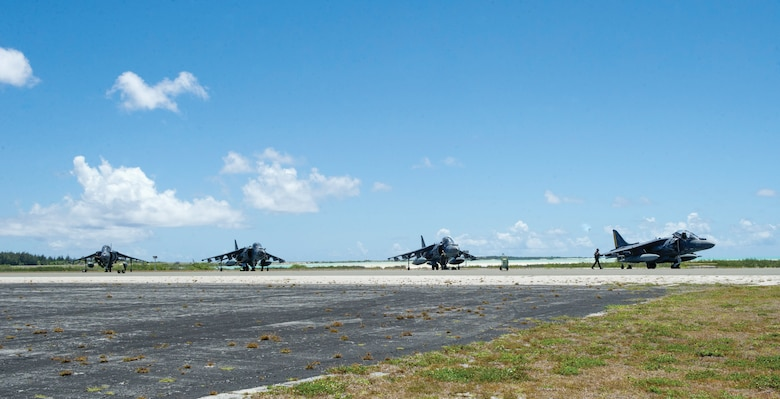 U.S. Marine Corps AV-8B Harriers from VMA-542 rest on the tarmac after landing at Wake Island Airfield in the mid-Pacific. Marine Attack Squadron 542 is based at Marine Corps Air Station Cherry Point, North Carolina. The Marines were participating in a trans-Pacific mission from the mainland U.S. to Japan. Joint Base Elmendorf-Richardson and Eielson Air Force Base personnel support the tiny detachment on Wake. (U.S. Air Force photo/1st Lt. Michael Trent Harrington)