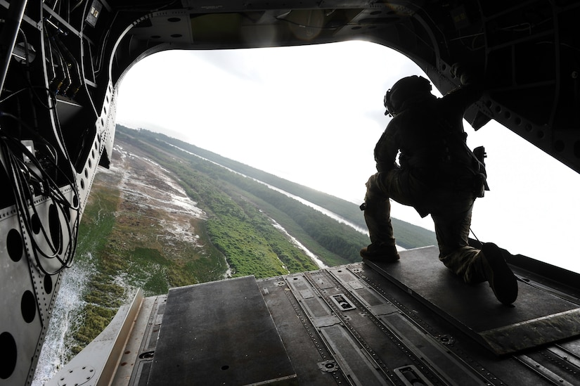 U.S. Army Sgt. King David, 1st Battalion, 228th Aviation Regiment crew chief, looks out the back of a CH-47 Chinook before landing in the Gracias a Dios department of Honduras during the twentieth iteration of Operation CARAVANA, June 9, 2016. CARAVANA is the name given to the recurring operation whereby Joint Task Force-Bravo provides the Honduran military with airlift support to give Honduran troops freedom of movement and access to outposts in the Gracias a Dios, Colón and Olancho departments to disrupt and deter illicit trafficking of drugs, weapons and money. (U.S. Air Force photo by Staff Sgt. Siuta B. Ika)