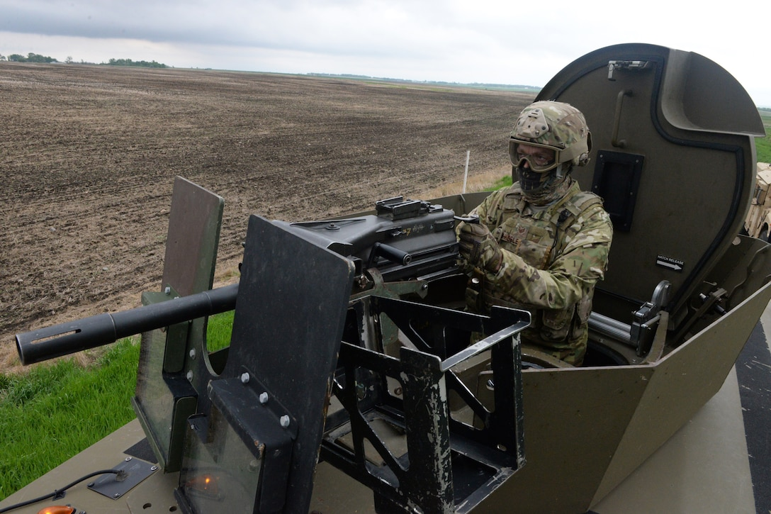 U.S. Air Force Staff Sgt. Joshua Wheeler, of the 219th Security Forces Squadron, simulates firing his MK-19 automatic grenade launcher during a training exercise requiring the recapture of a launch facility after a simulated hostile take-over of the facility in the Minot Air Force Base Missile Field Complex, near Minot, North Dakota, May 25, 2016. He is one of the North Dakota Air National Guard members who took primary positions for missile filed security in an entire 'sector' of the missile field complex during a two week period from May 23 through June 4. This is the fourth time such an annual training surge has happened with the 219th SFS in the complex, which covers 8,500 square miles over the North Dakota plains near Minot and includes dozens of missile field alert facilities and missile launch facilities. (U.S. Air National Guard Photo by Senior Master Sgt. David H. Lipp/Released)