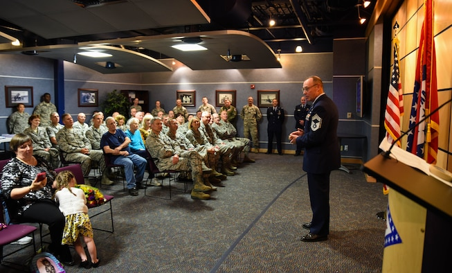 Chief Master Sgt. Ricky Sehorn, chief of transportation, speaks to Airmen in attendance June 4, 2016, during his promotion ceremony at Ebbing Air National Guard Base, Fort Smith, Ark. Sehorn has served in vehicle maintenance for the past 24 years and has been chief of transportation since 2014. (U.S. Air National Guard photo by Senior Airman Cody Martin/Released)