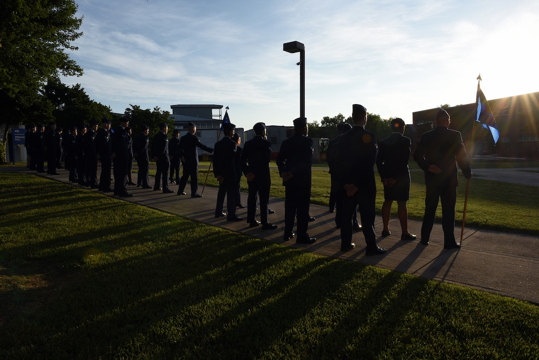 Airmen hold reveille in the sunrise during Airman leadership school at the Chief Master Sergeant Paul H. Lankford Enlisted Professional Military Education Center, June 16, 2016, on McGhee Tyson Air National Guard Base in Louisville, Tenn. (U.S. Air National Guard photo by Master Sgt. Mike R. Smith/Released)