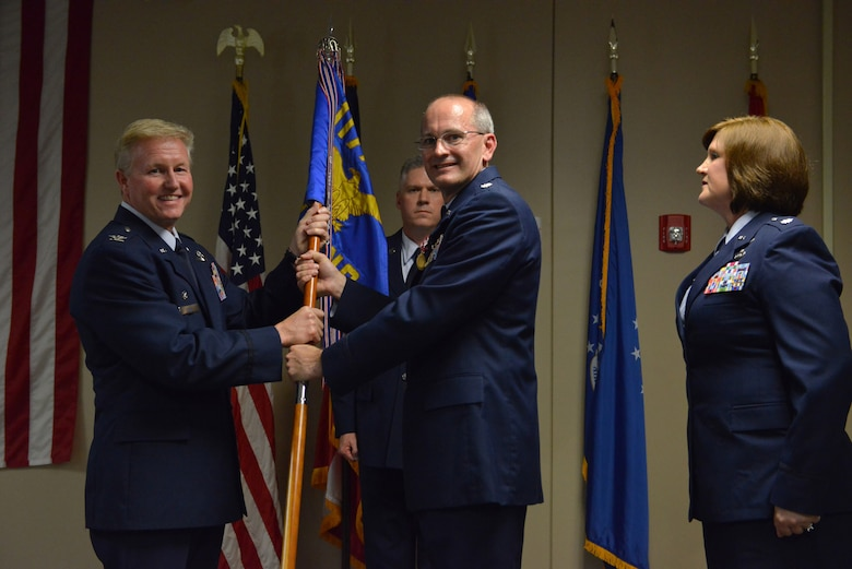 U.S. Air Force Col. Hal Davis the Operations Group commander holds the 117th  Air Control Squadron with Lt. Col. Ronald Speir during a change of Command Ceremony at the 117th Air Control Squadron and Hunter Army Airfield, Ga., June 10, 2016. Speir relinquished command of the 117 ACS and will be taking a new position at the Joint Force Readiness Center in Atlanta, Ga. (U.S. Air National Guard photo by Tech. Sgt. Amber Williams/Released)