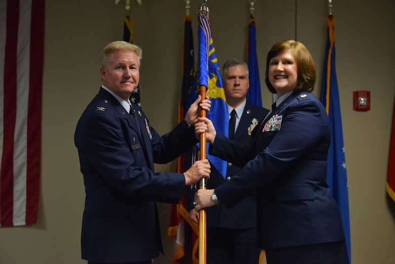 U.S. Air Force Col. Hal Davis the Operations Group commander holds the 117th  Air Control Squadron with Lt. Col. Elizabeth Baker during a change of Command Ceremony at the 117th Air Control Squadron and Hunter Army Airfield, Ga., June 10, 2016. (U.S. Air National Guard photo by Tech. Sgt. Amber Williams/Released)