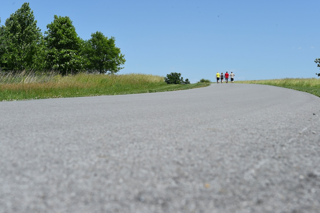 132nd Intelligence Surveillance and Reconnaissance Group members finish the last stretch of the race, June 6, 2016, at Moffitt Resevoir Park in Cumming, Iowa. The ISRG held an amazing race event to kickstart Annual Training Week. (U.S. Air National Guard photo by Staff Sgt. Michael J. Kelly/Released)