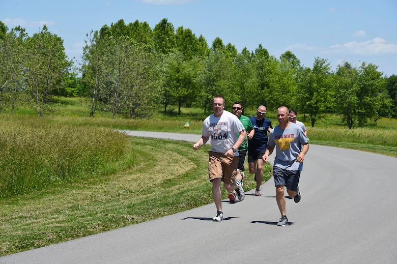 132nd Intelligence Surveillance and Reconnaissance Group members run down a road June 6, 2016, at Moffitt Resevior Park in Cumming, Iowa. The ISRG held an amazing race event to kickstart Annual Training Week. (U.S. Air National Guard photo by Staff Sgt. Michael J. Kelly/Released)