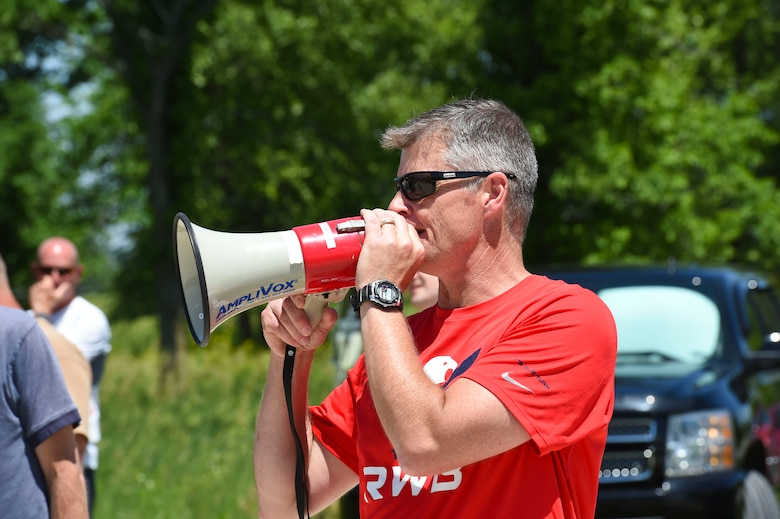 Chief Master Sgt. James Holwegner, the 132nd Intelligence Surveillance and Reconnaissance Group superintendent, shouts instructions June 6, 2016, at Moffitt Resevoir Park in Cumming, Iowa. The ISRG held an amazing race event to kickstart Annual Training Week. (U.S. Air National Guard photo by Staff Sgt. Michael J. Kelly/Released)