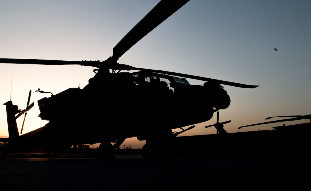 A 40th Combat Aviation Brigade Apache sits on the flightline at Forward Operating Base Fenty, Afghanistan. (Army photo by Staff Sgt.  Ian M. Kummer)