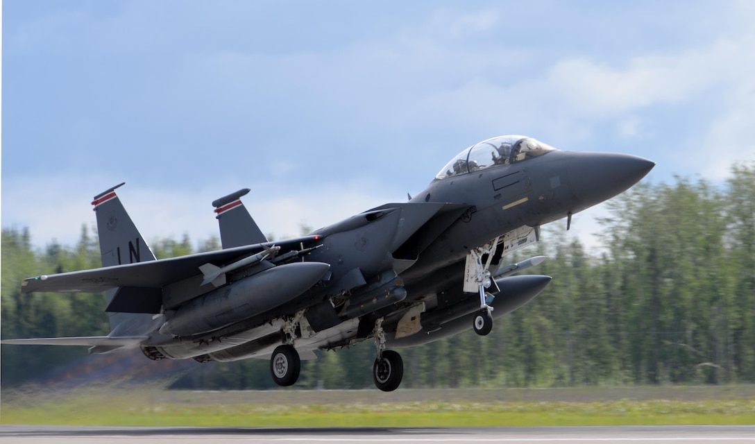 An F-15E Strike Eagle, assigned to the 494th Fighter Squadron out of Royal Air Force Lakenheath, England, gains speed as it takes off from Eielson Air Force Base, Alaska, June 6, 2016, during Red Flag-Alaska 16-2. Red Flag-Alaska missions are conducted over the Joint Pacific Alaska Range Complex, more than 67,000 square miles of airspace that includes one conventional bombing range and two tactical bombing ranges containing 510 different types of targets and 45 threat simulators. (U.S. Air Force photo/Master Sgt. Karen J. Tomasik)