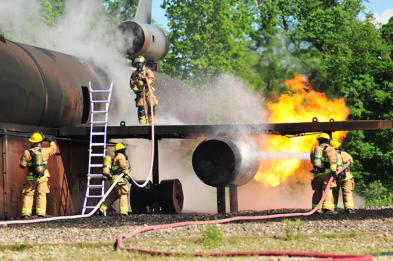 Pennsylvania Air National Guardsmen with the 171st Air Refueling Wing's Fire Protection Flight participate in an annual training exercise at the Pittsburgh International Airport's Air Rescue and Firefighting facility June 7, 2016. The exercise simulated an aircraft crash, burn and rescue procedures. (Air National Guard photo/Staff Sgt. Allyson L. Manners)