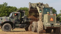 Marines with Company C, 6th Engineer Support Battalion, 4th Marine Logistics Group, Marine Forces Reserve, clear dirt from a parking lot construction site with help of commandos with 131 Commando Squadron Royal Engineers, British army, during exercise Red Dagger at Fort Indiantown Gap, Penn., June 11, 2016. As part of the exercise, the Marines and British commandos worked on various renovation and construction projects around the Army base. Exercise Red Dagger is a bilateral training exercise that gives Marines an opportunity to exchange tactics, techniques and procedures as well as build working relationships with their British counterparts.