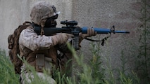 Sgt. Nicholas A. Skaggs, a platoon sergeant with Company C, 6th Engineer Support Battalion, 4th Marine Logistics Group, Marine Forces Reserve, provides security on a building during a simulated raid on an urban compound during exercise Red Dagger at Fort Indiantown Gap, Penn., June 13, 2016. Exercise Red Dagger is a bilateral training exercise that gives Marines an opportunity to exchange tactics, techniques and procedures as well as build working relationships with their British counterparts.