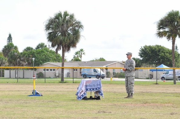 Brig. Gen. Wayne R. Monteith, 45th Space Wing commander, kicks off the 45th Space Wing's All SySTEMs Go event with a model rocket launch June 11, 2016, at the Youth Center/Shark Center at Patrick Air Force Base, Fla. The event is designed to teach children of all ages about science, technology, engineering and math. (U.S. Air Force Photo/Tech. Sgt. Erin Smith/Released)