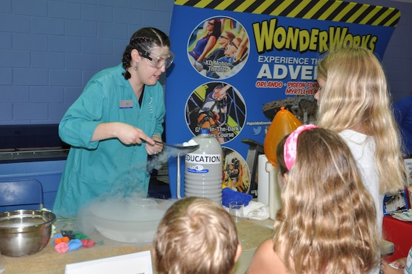 Emily Hill, Orlando Science Center Education Team, teaches children about the states of matter by using marshmallows and liquid nitrogen during the 45th Space Wing's All SySTEMs Go event June 11, 2016, at the Youth Center/Shark Center at Patrick Air Force Base, Fla. The event was designed to teach children of all ages about science, technology, engineering and math. (U.S. Air Force Photo/Tech. Sgt. Erin Smith/Released)